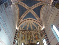 The starry ceiling of San Zeno, a place for a young woman to lose herself.